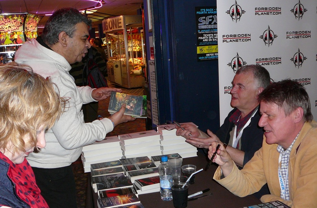 Ken MacLeod (second right) chats with a fan