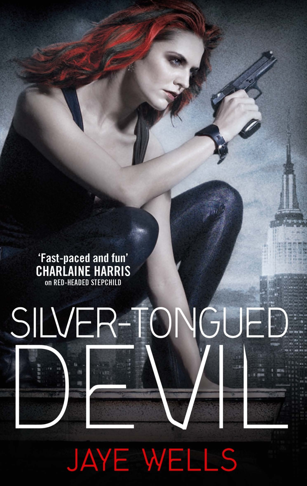 The cover to Jaye Wells' Silver-Tongued devil, showing a red-headed woman holding a gun