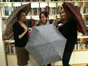 Members of the Orbit Books tema posing with parasols to promote the author Gail Carriger's UK tour (author of TIMELESS from The Parasol Protectorate series)