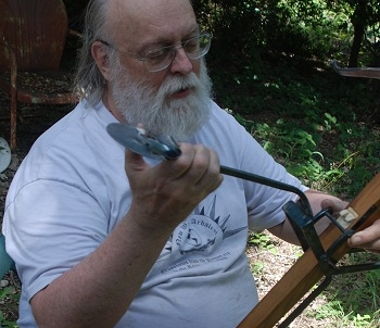 David Watson demonstrating how a gafa or goatsfoot lever is used to span crossbow