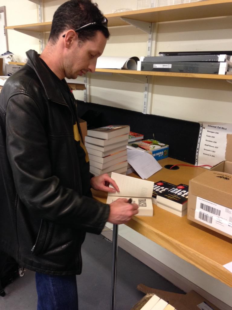 Rob Boffard signing copies of Tracer