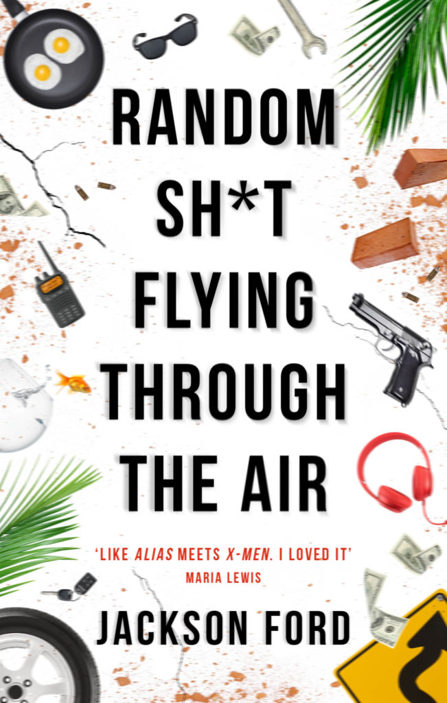 The new cover for RANDOM SH*T FLYING THROUGH THE AIR, containing images of various random items including a walkie talkie, a pair of sunglasses, a revolver and two eggs in a frying pan.