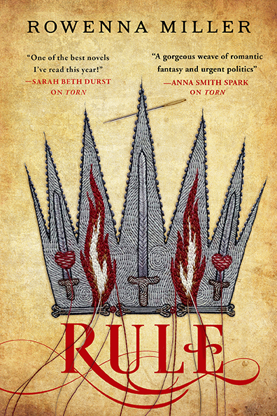 Book cover of Rule by Rowenna Miller. Cover shows embroidery of a silver crown wreathed in fire.